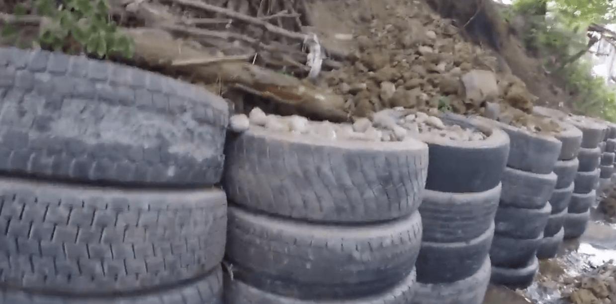 Возведение подпорной стены из шин